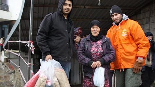 Syria refugees receive blankets from CARE staff to help survive winter. Credit: Johanna Mitscherlich/CARE