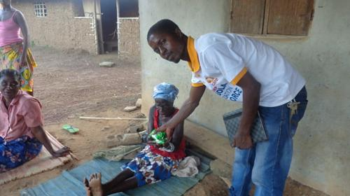 CARE staff doing Ebola awareness in community. PHOTO: Hilary Sims/CARE