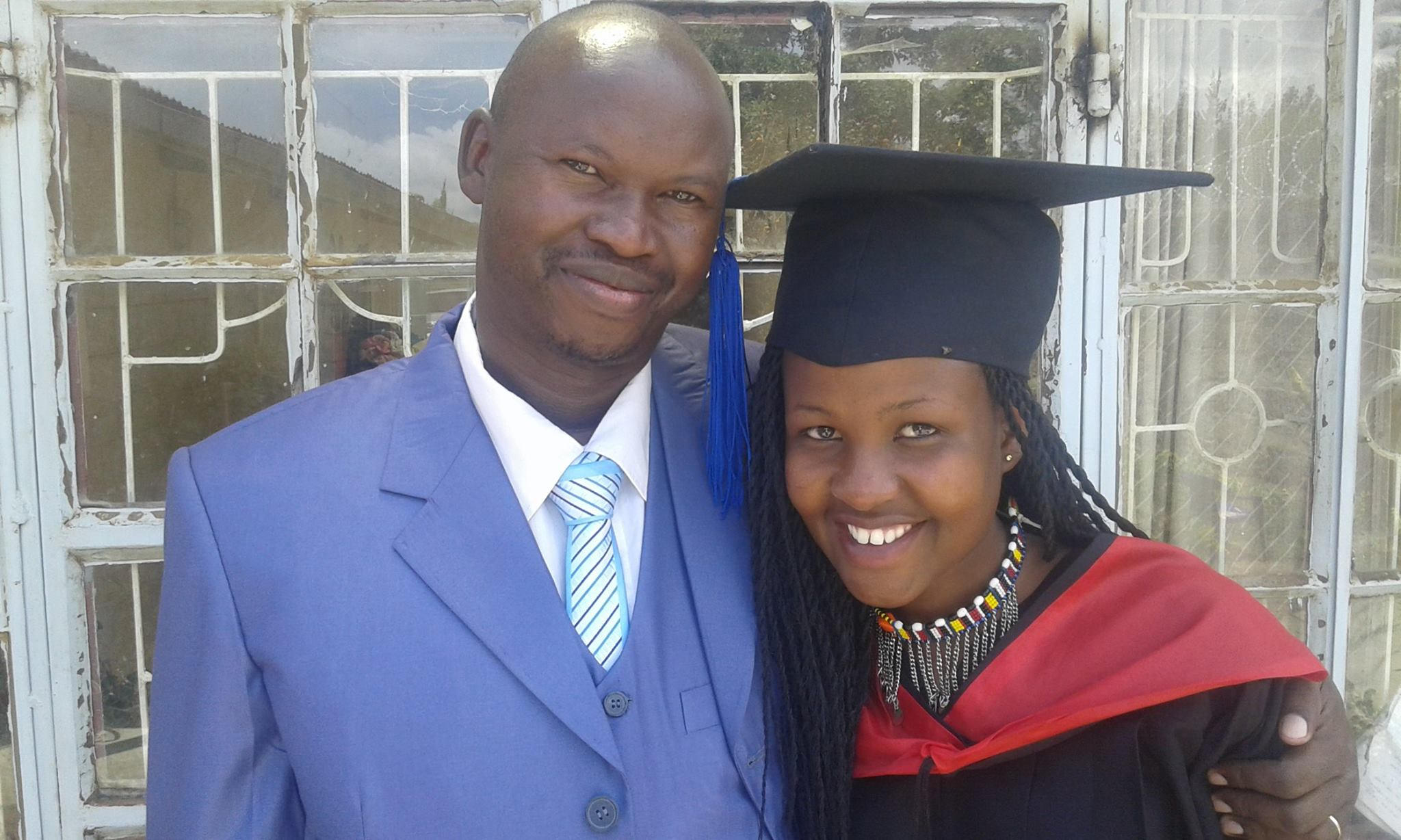 House of Hope Rescue Centre founder Patrick Ngigi (left) with a student who benefitted from the center's support system. Photo: Courtesy House of Hope Rescue Centre/Mission With a Vision