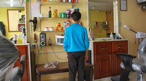 Aboud, 12, fled with his family to Mafraq, Jordansix weeks ago. Instead of attending school, he works in a barber shop from 9:00 in the morning until 10:30 at night, sweeping the floor and cleaning scissors. His 13-year-old brother must work as well to help make ends meet.