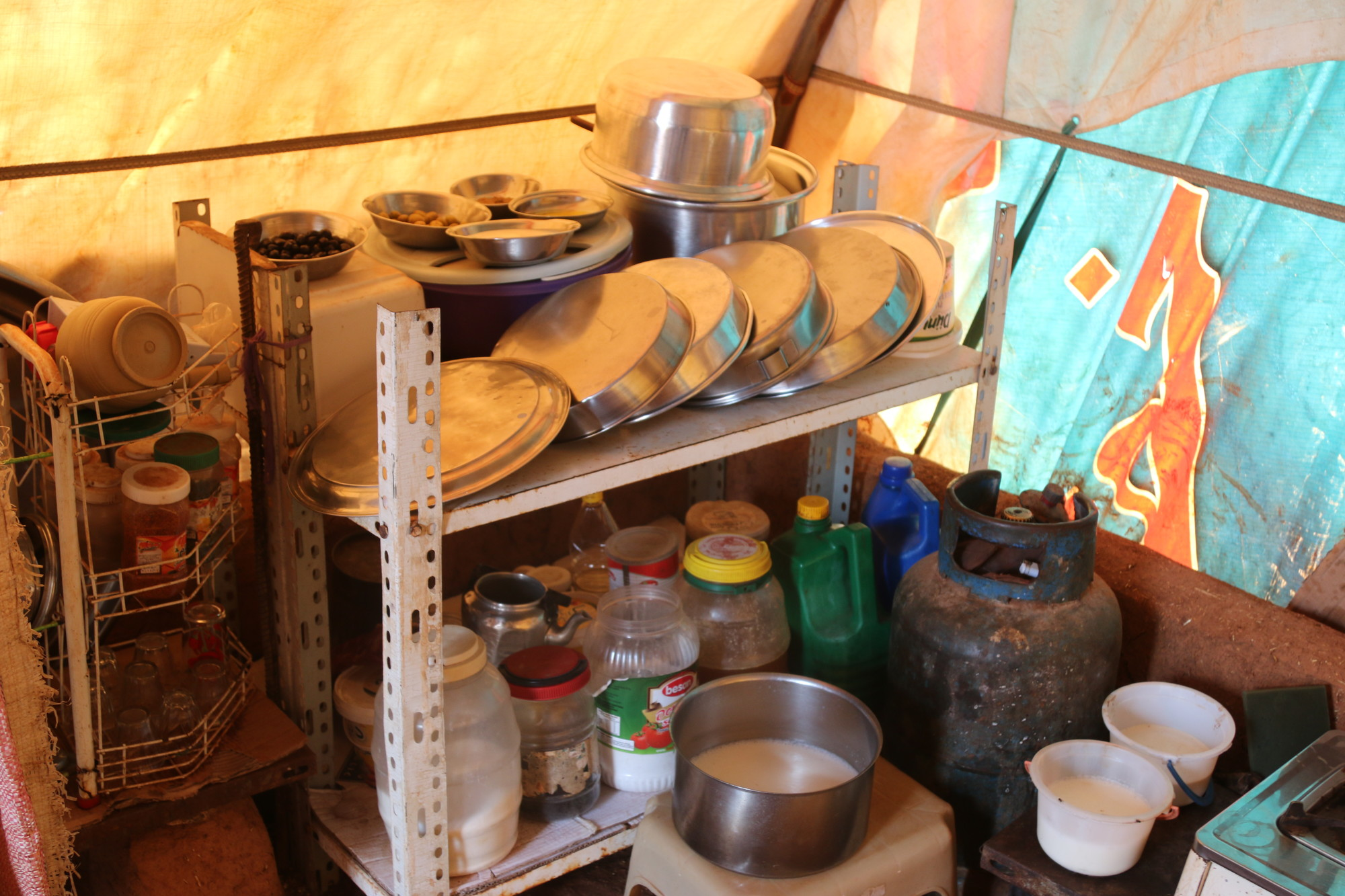 A few of the belongings in Amira's tent that are helping her family survive.