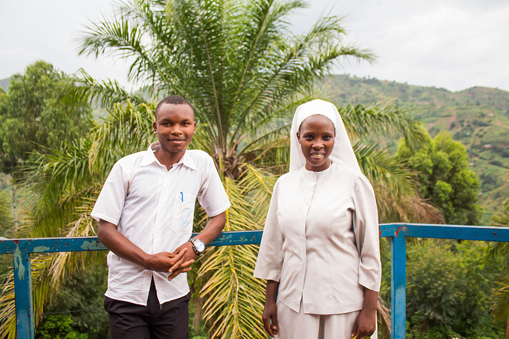 Novence Twagirayezu, left, says Sister Philotte, right, has helped change his perceptions about menstruating women. Photo: Ninon Ndayikengurukiye/CARE