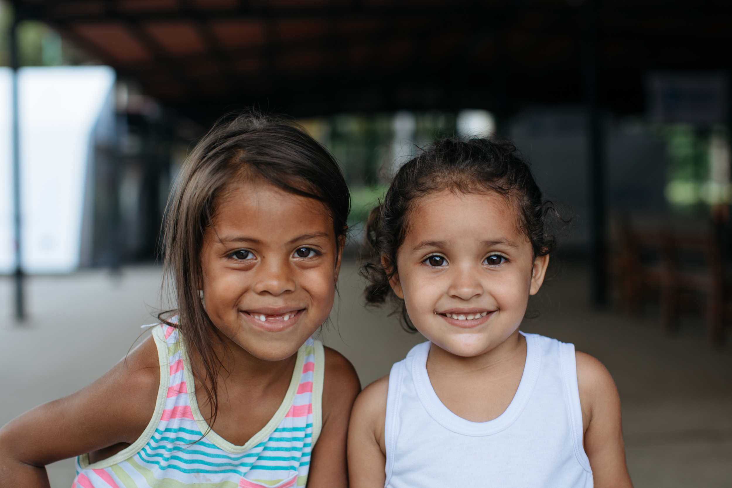 Salma, left, and Ariana, right, fled Venezuela with their family. Photo credit: Paddy Dowling
