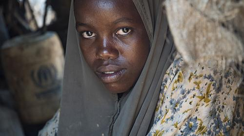 Eleven-year-old Safiyo sits in her home in Dadaab refugee camp, one of the largest refugee camps in the world.