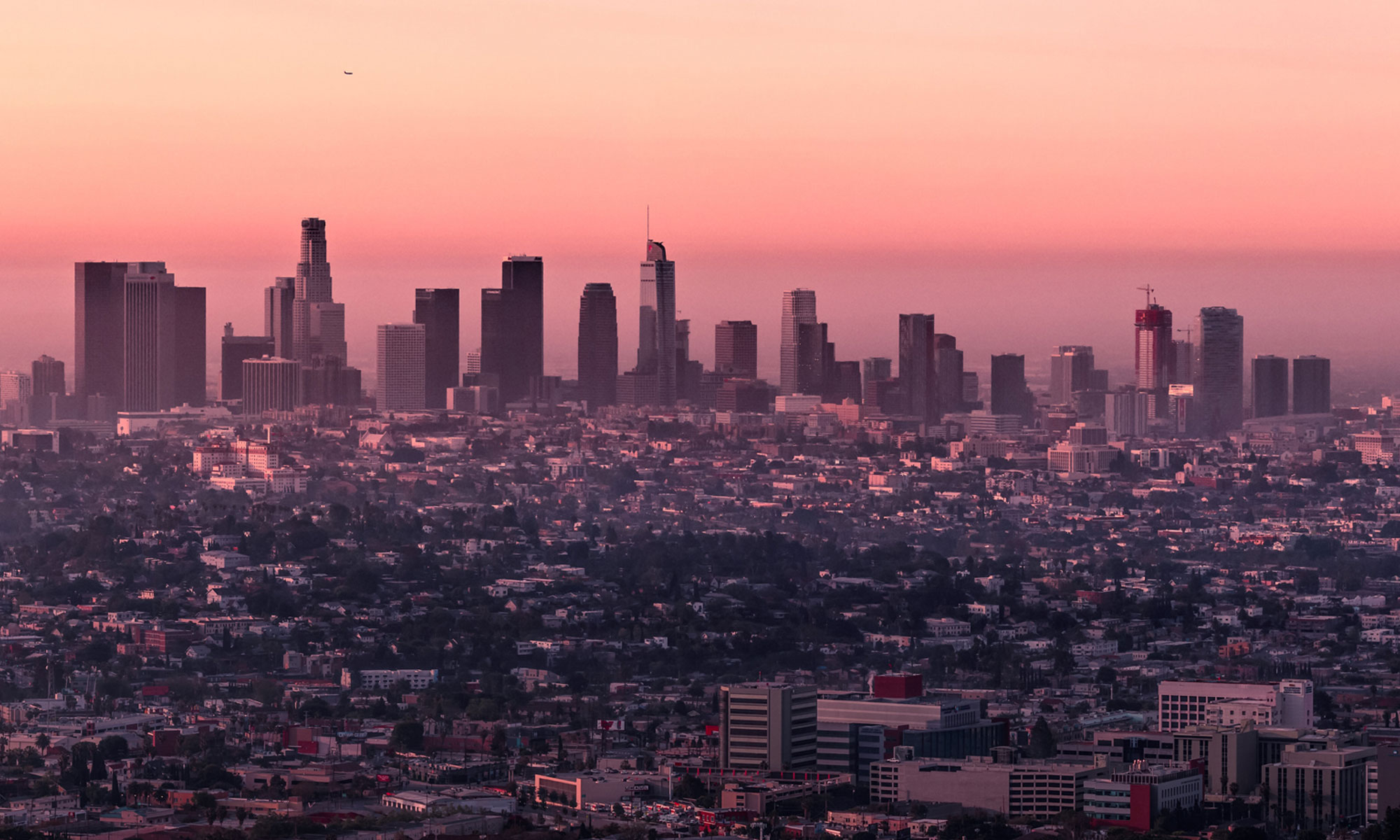 Los Angeles skyline at sunrise.