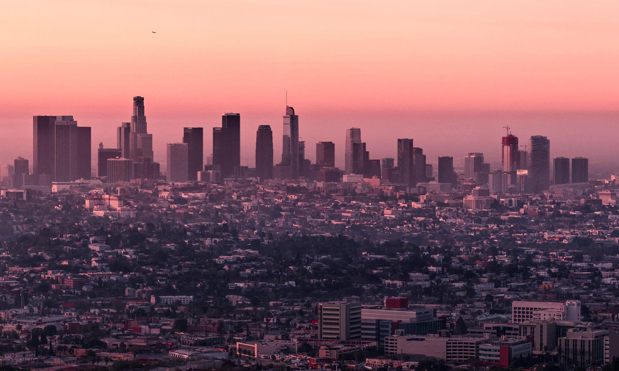 Los Angeles skyline at sunrise.