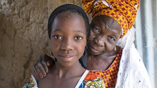 CARE VSLA member Fatchima opened new doors for her granddaughter, Nana.