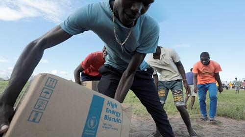 High-energy biscuits and bottles of water are being flown to isolated villages, islands among the flood waters. CARE staff continued distributing shelter and sanitation kits to communities affected by the destructive Cyclone Idai in Malawi and Mozambique. Credit: Josh Estey/CARE