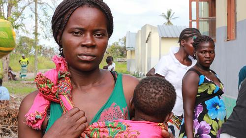"""Linda Bene Lewane, 29, has been eating just one meal a day since the cyclone hit. On April 10, the mother of three children went to one of CARE's last food distributions in the region even though she was not registered on the distribution list. """"I am here to support my neighbors. They can't carry the food to their homes by themselves. I hope they will have a heart for me and my children and share with us. It has been too many nights going to bed with an empty stomach."""" Credit:Ninja Taprogge/CARE"""