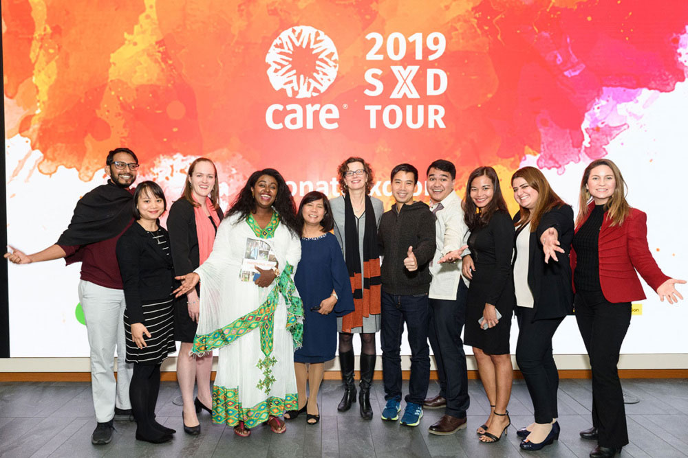 A group of people pose for a photo on the 2019 Scale by Design tour.