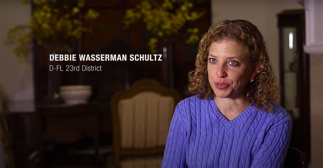 Rep. Debbie Wasserman Schultz sits down in a room for an interview.
