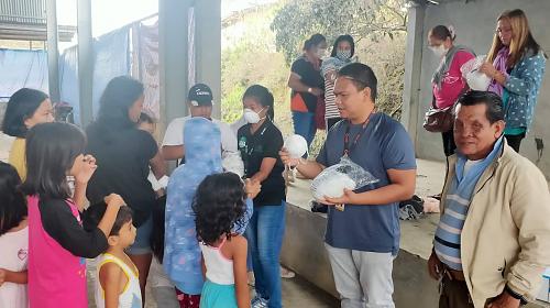 CARE distributing masks after volcano