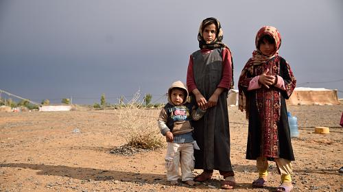 2 year old Zaid, 11 year old Amina and 8 year old Shoaa have been displaced fromSyria. The children's mother was killed inSyriaand they have been living with their father and the rest of their small community of 14 other families in Jordan since 2012. Photo: Lucy Beck/CARE