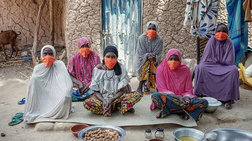 Women continue working outside their home in Niger. Since COVID-19, it has become much harder for them to make a profit off of their peanut plants, so they are often unable to afford basic necessitieslike food.Photo byOllivier Girard/CARE