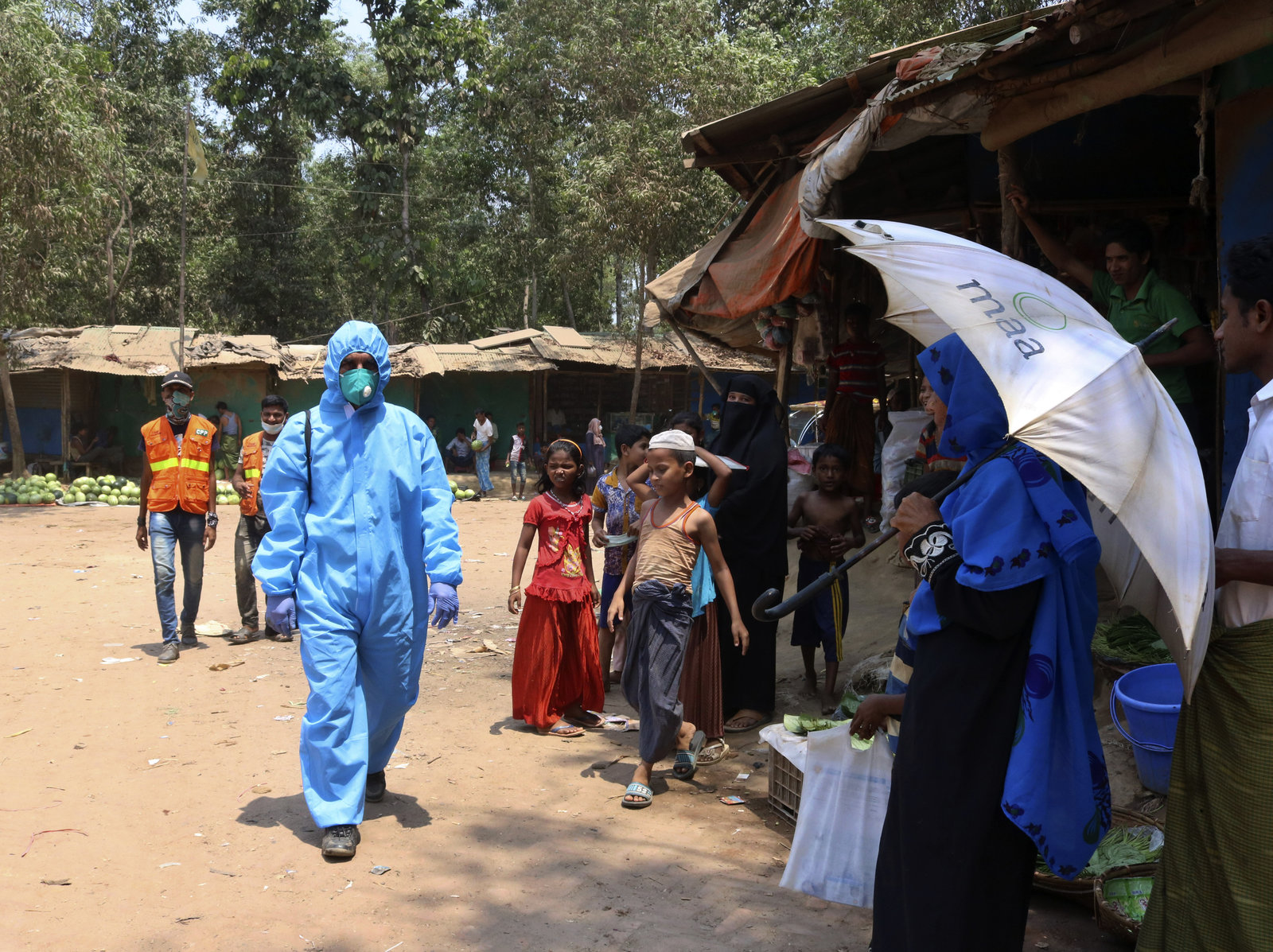 A health worker wearing personal protective equipment in the Kutupalong Rohingya refugee camp in Cox's Bazar, Bangladesh, last month. On Thursday, Bangladesh reported the area's first confirmed coronavirus infections. Shafiqur Rahman/AP