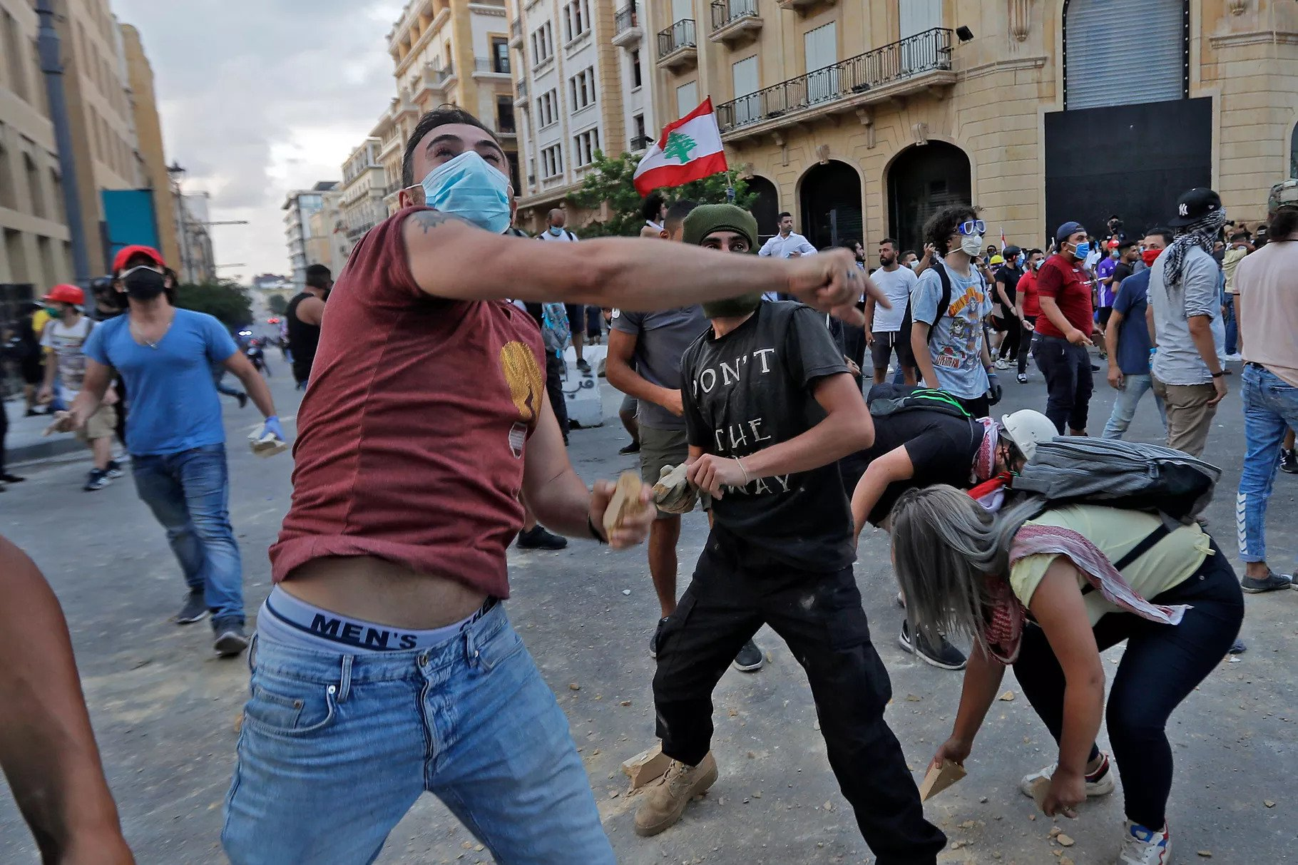 Lebanese protesters, enraged by last week's deadly Beirut explosion, hurl stones at security forces amid clashes in the vicinity of the parliament building in central Beirut on August 10, 2020. Joseph Eid/AFP via Getty Images