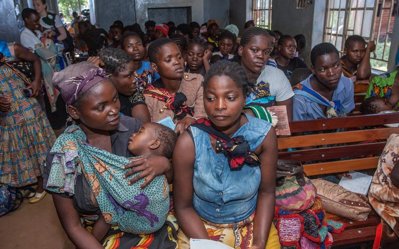 Mothers waiting at a clinic with their babies in 2019, before the pandemic shut down many similar services CREDIT: AFP