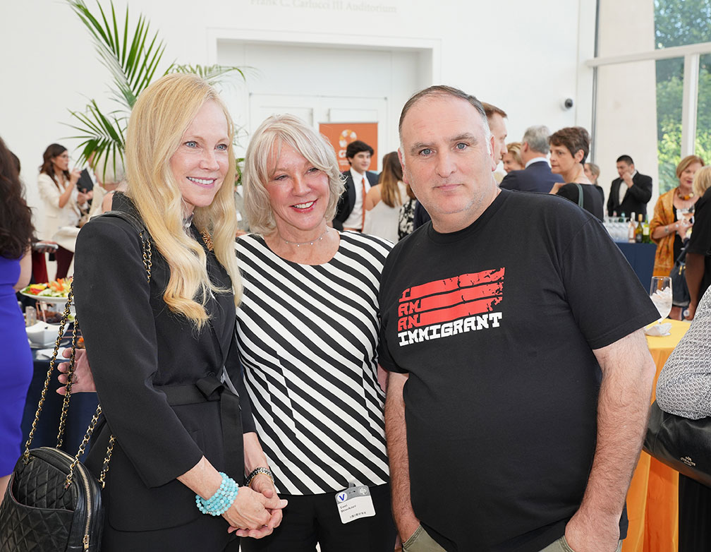 Chef José Andrés stands with two attendees at the Global Leaders Network Awards Reception.