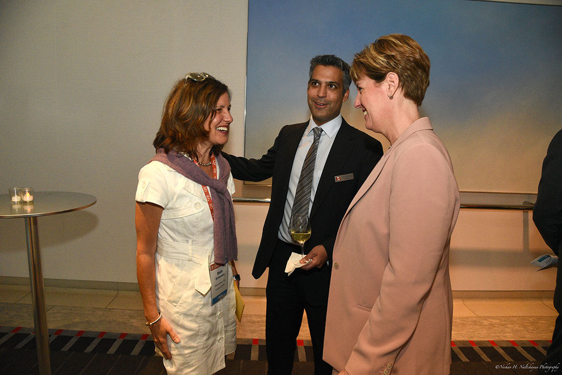 Beth Solomon, who works at CARE, speaks with Minister Marie-Claude Bibeau and a representative from the Embassy of Canada.
