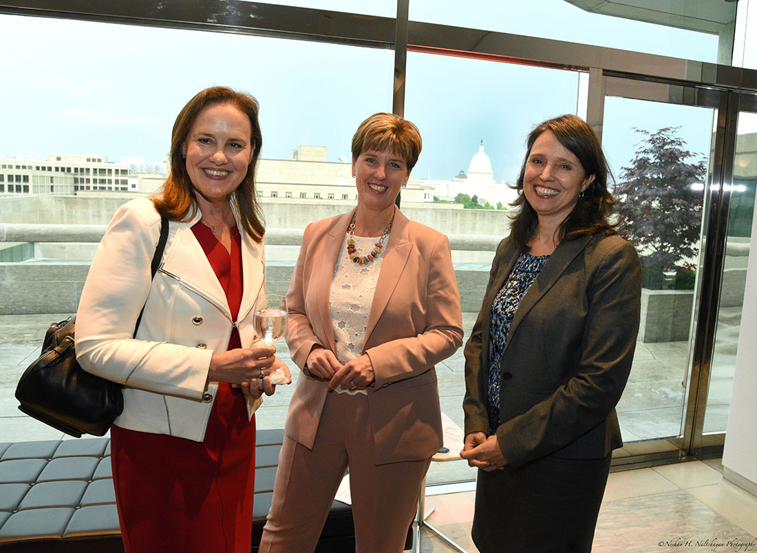 Michéle Flournoy, Minister Marie-Claude Bibeau, and another woman stand together.