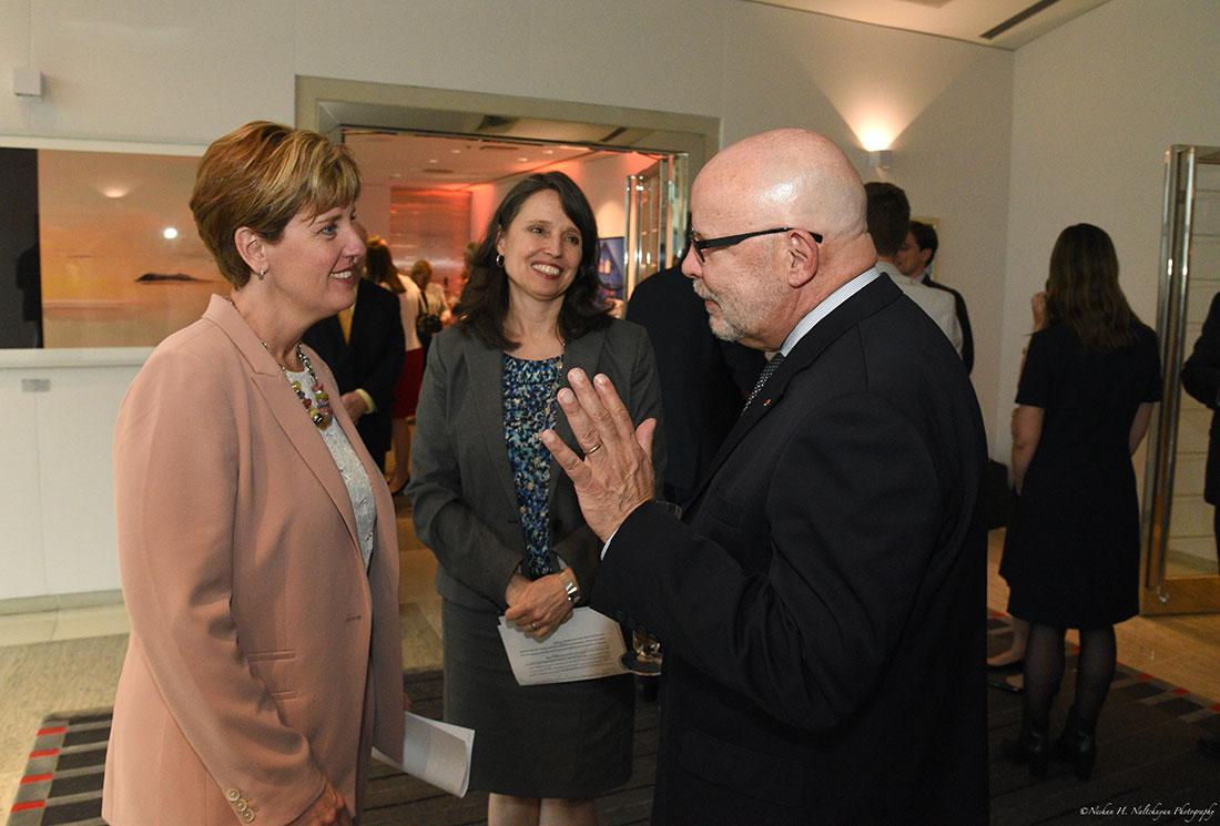A man greets Minister Marie-Claude Bibeau after her speech.