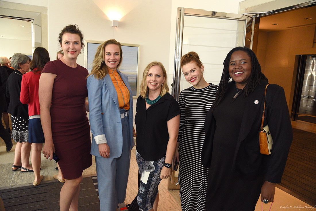 Actresses Danielle Savre and Holland Roden stand with other attendees at the Embassy of Canada.