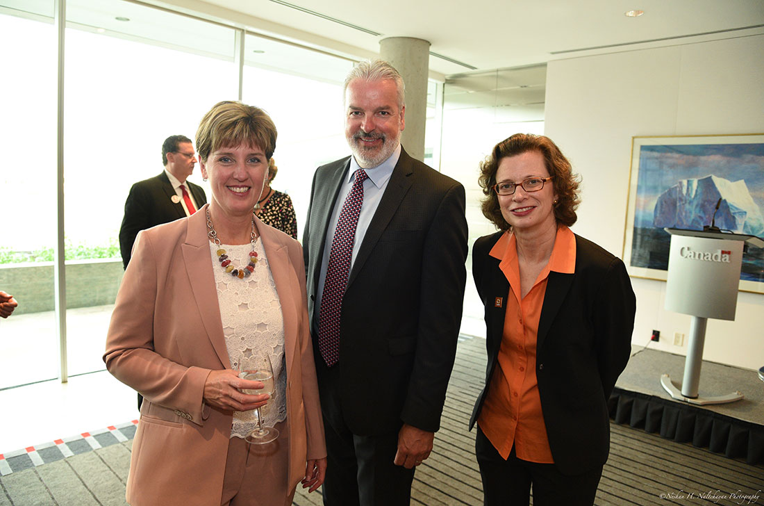 CARE CEO Michelle Nunn stands for a photo with a man and woman.