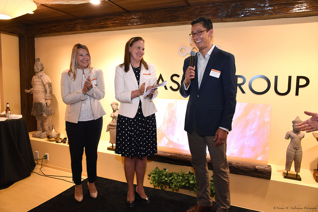 Former Under Secretary Michéle Flournoy and former CARE COO Heather Higginbottom clap while Rexon Ryu, partner of The Asia Group, speaks to the crowd.