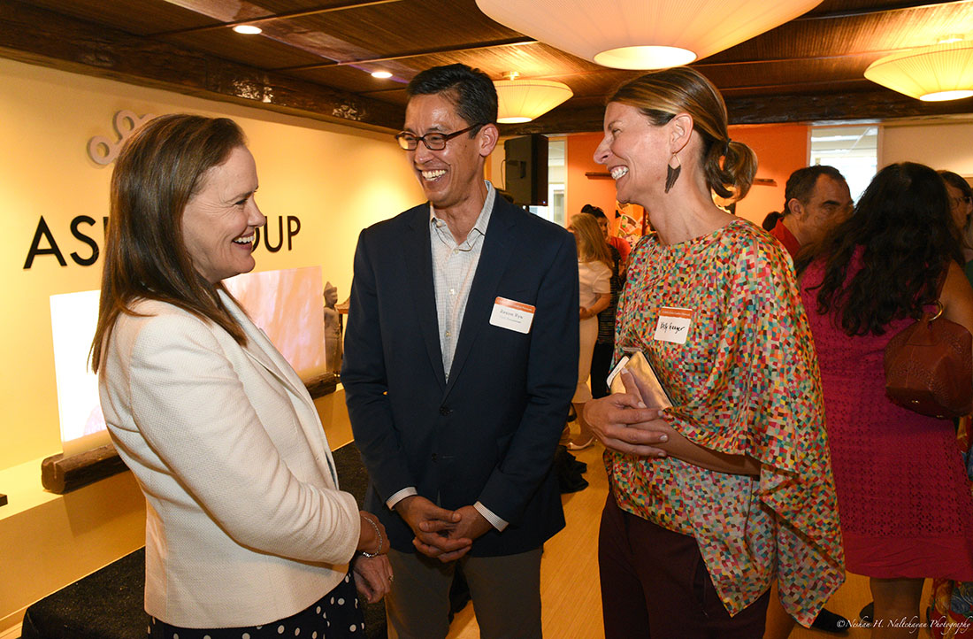 Former Under Secretary Michéle Flournoy speaks with Rexon Ryu, partner of The Asia Group, and an attendee.