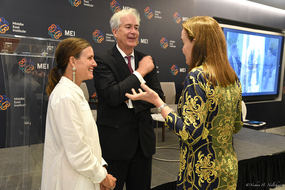 Michéle Flournoy and Ambassador William Burns speak with an attendee.