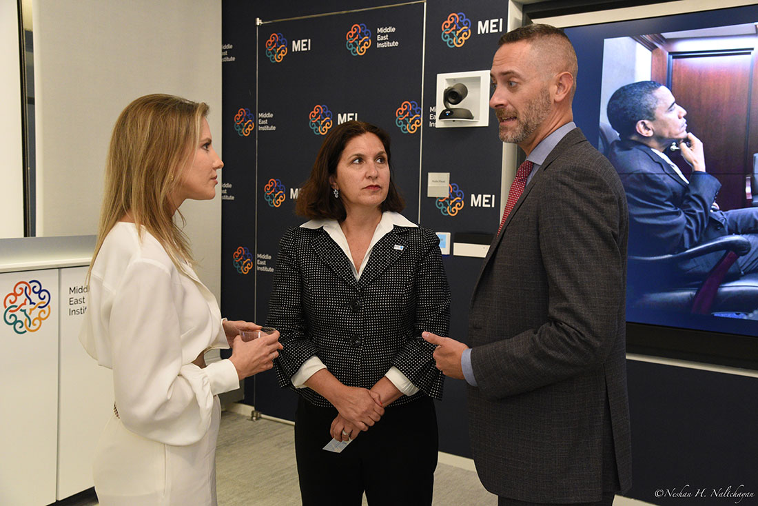 CNN senior diplomatic correspondent Michelle Kosinski speaks with two attendees.