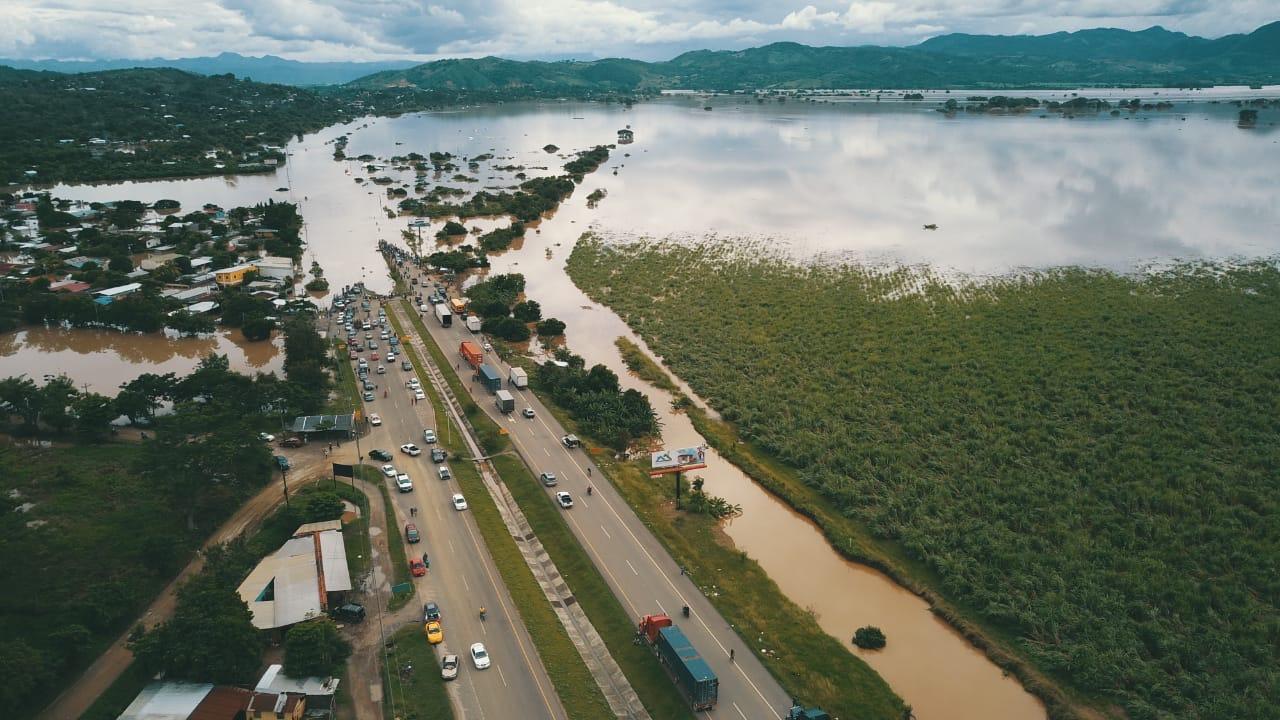 Flood waters engulf a road in Honduras.