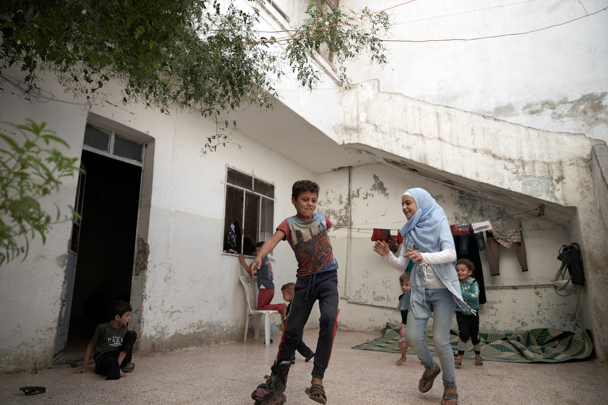 Children play in front of a house.