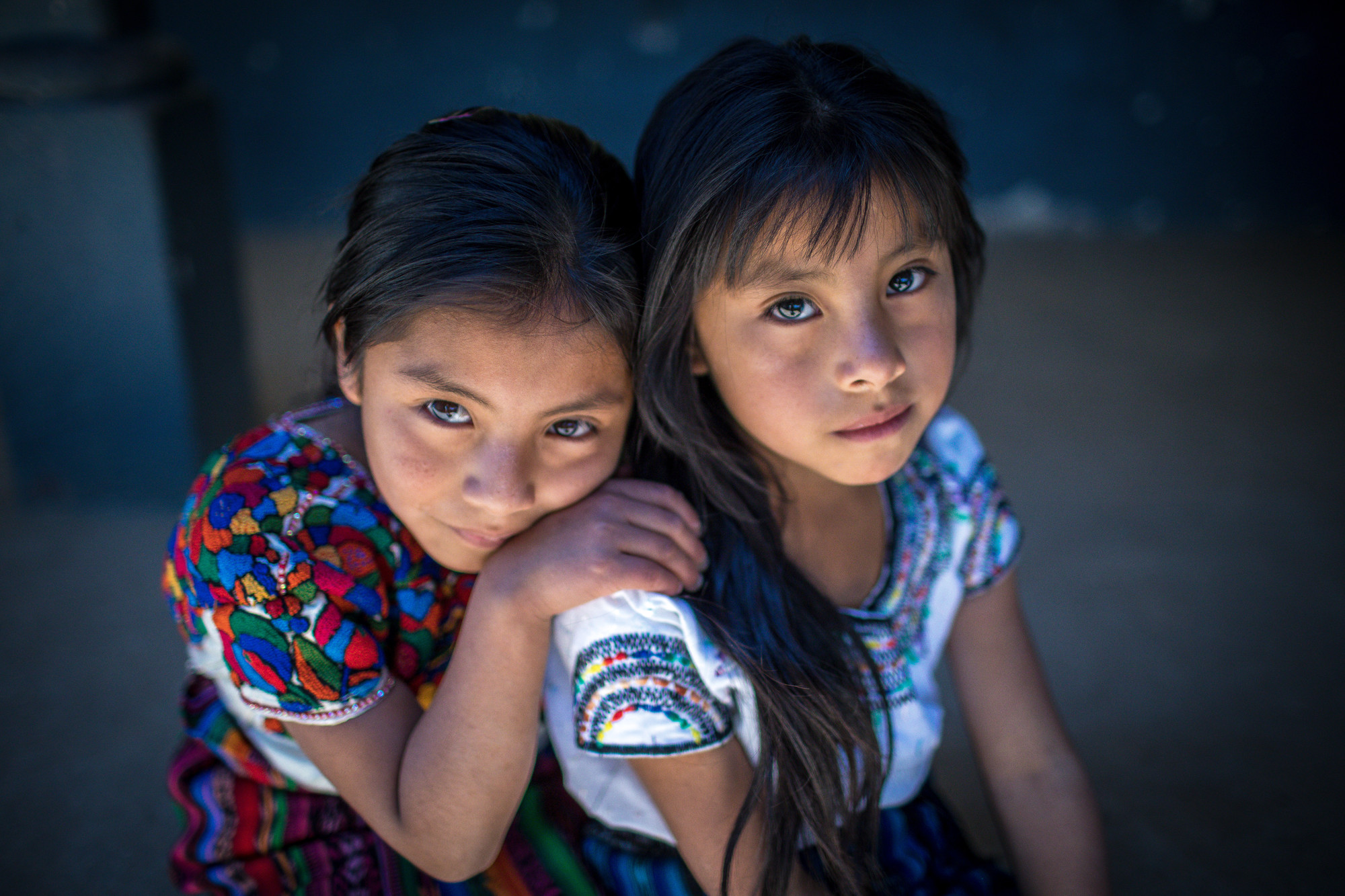 Two girls look up directly ahead.