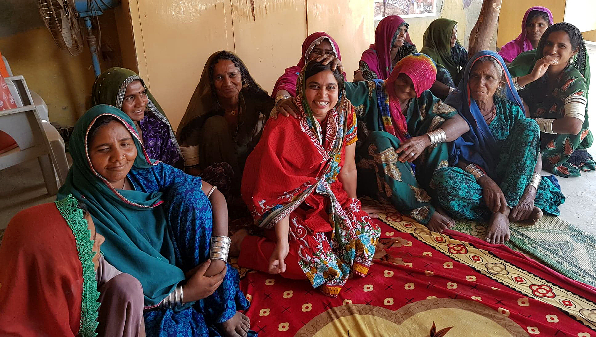 A group of happy women sit together.