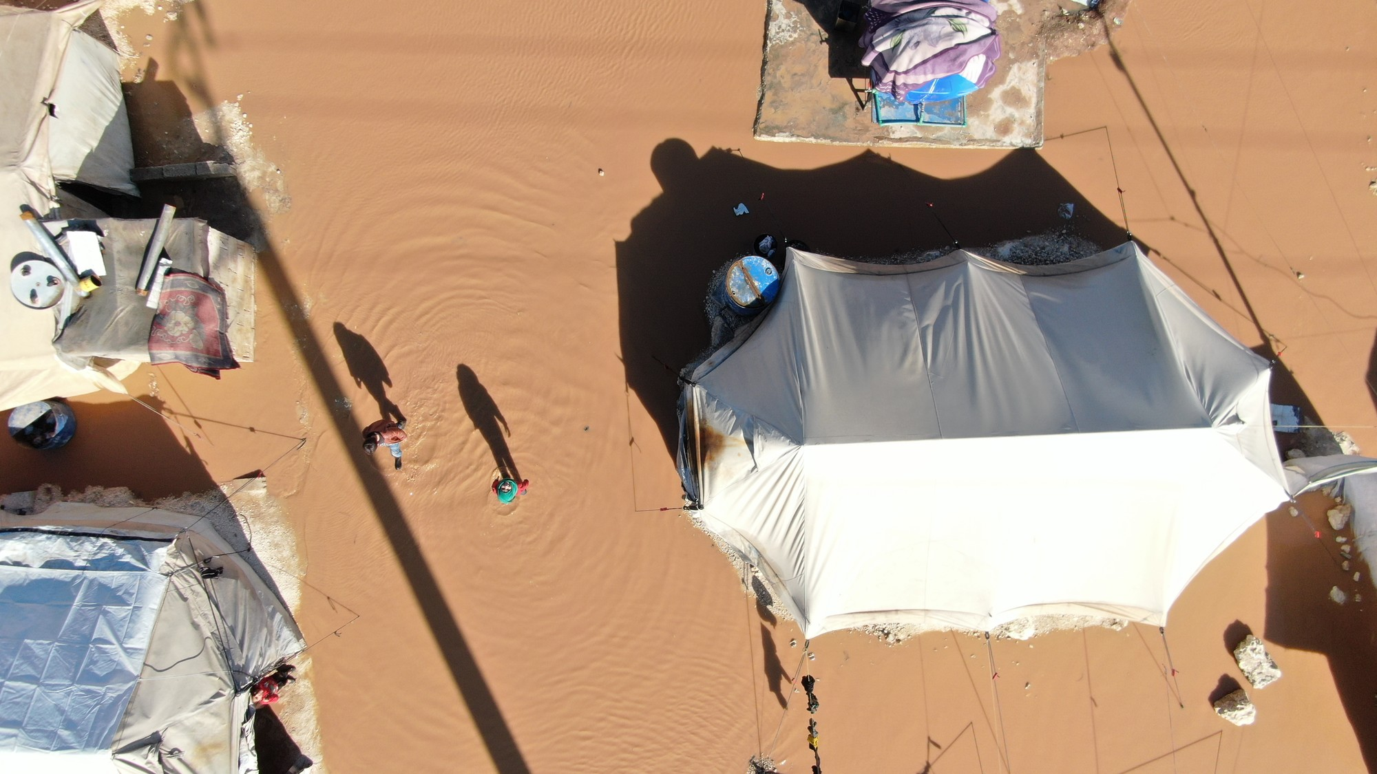 An overhead view of a flooded camp.