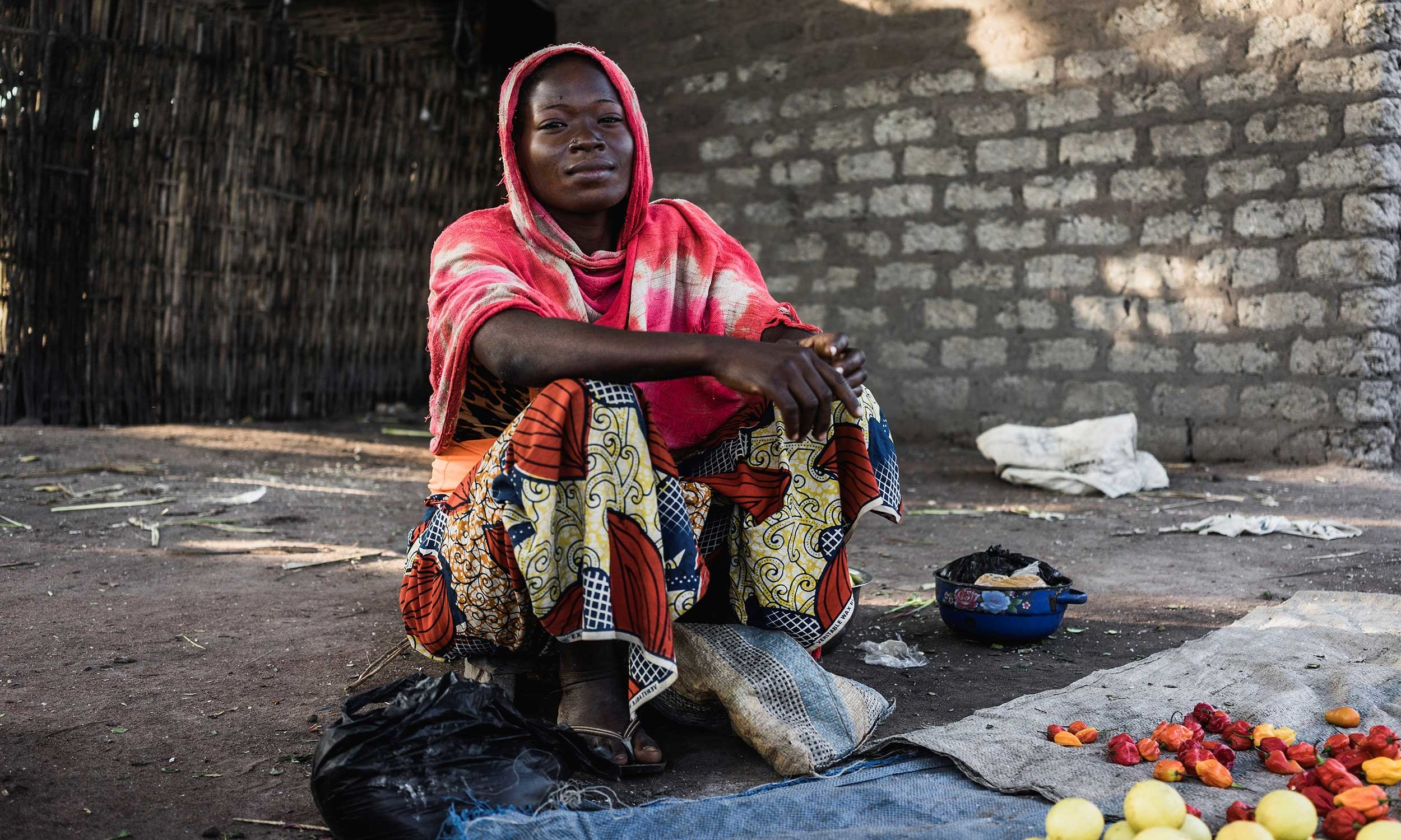 A woman sits outside.