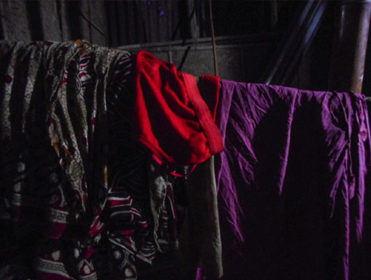 Dark clothing hung up on a wire.