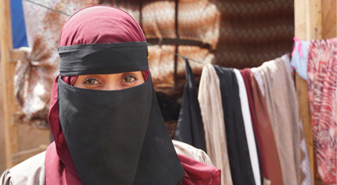 A portrait of a woman in a niqab.