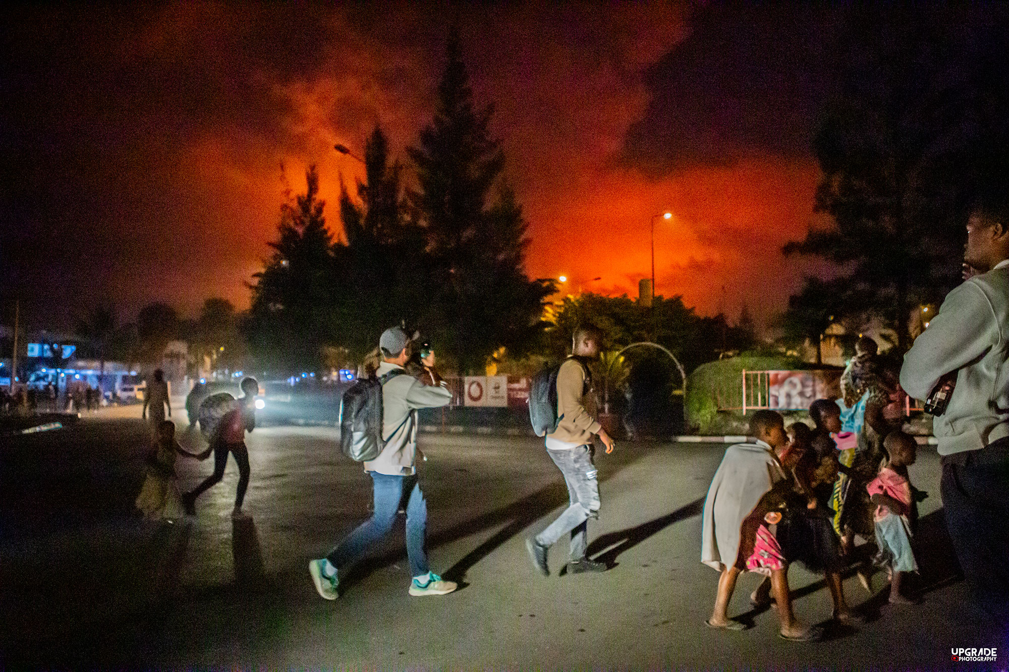 People in Goma, DRC evacuate the city after a volcanic eruption.