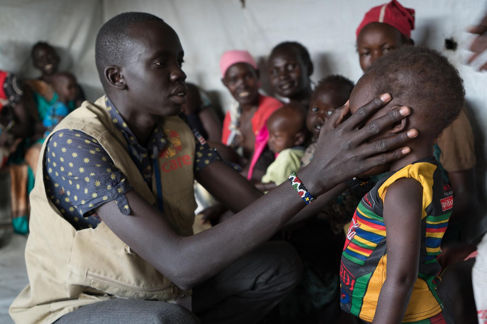CARE staff in South Sudan check children for malnutrition at the health center.